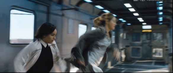 Christina and Tris jumping off the train